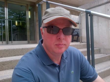 Chris Erskine, Urban Landscape Artist, outside the campus art gallery